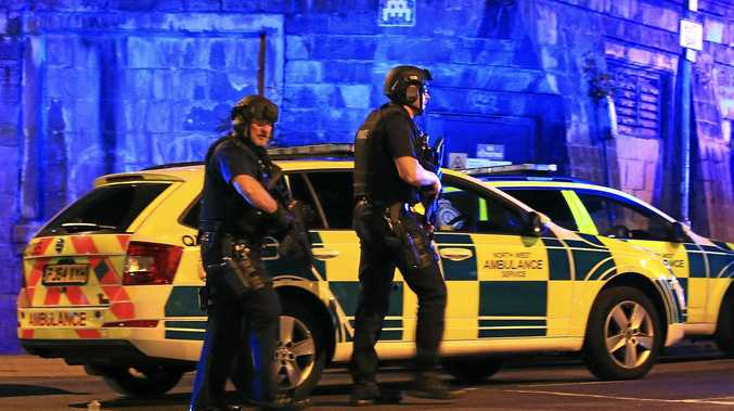 Armed police at Manchester Arena after the explosion rocked an Ariana Grande gig on Tuesday morning Australian time.