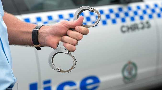 NSW police at coffs harbour boat ramp, arrest , gun, shots, handcuffsPhoto: Trevor Veale / The Coffs Coast Advocate