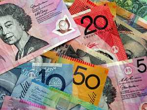 Woman a 'winner and grinner' after scratching $100,000