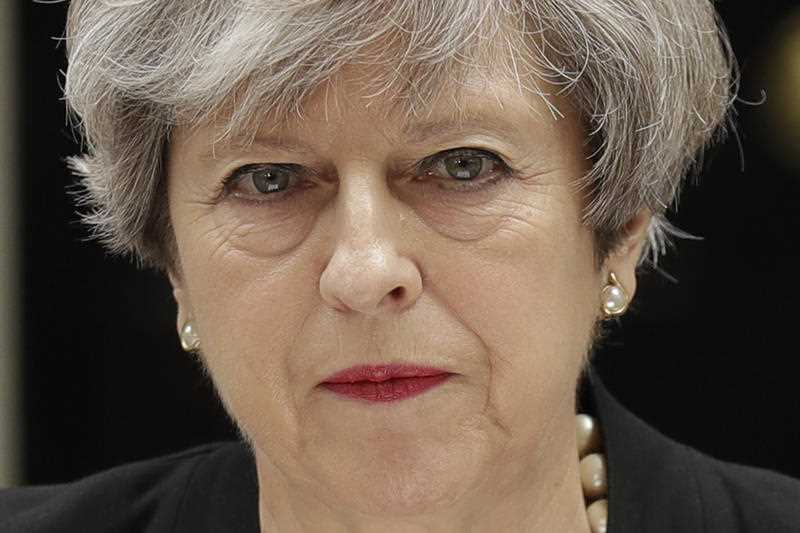British Prime Minister Theresa May addresses the media outside 10 Downing Street, London, Tuesday May 23, 2017, the day after an apparent suicide bomber attacked an Ariana Grande concert as it ended Monday night, killing over a dozen of people among a panicked crowd of young concertgoers.