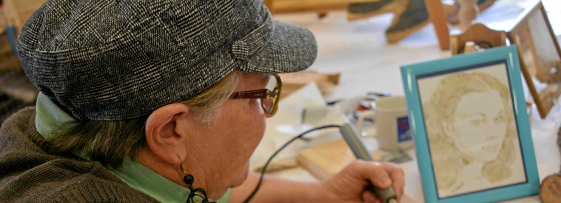 Bessie Smith demonstrates pyrography at the Blackbutt Show