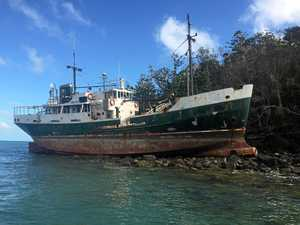 SALVAGE JOB: A boat washed up at Cid Harbour is set to be removed in coming days.