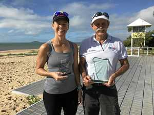 WINNER: Three time champion of the Laura Pettifer Memorial Triathlon, Deonne McMurtrie, being presented her award by Laura's father Jeff Pettifer.