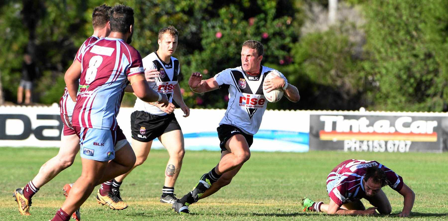 FENDING OFF: Jamie Lowien races up for Eastern Suburbs in the A Grade game at Salter Oval in Bundaberg.