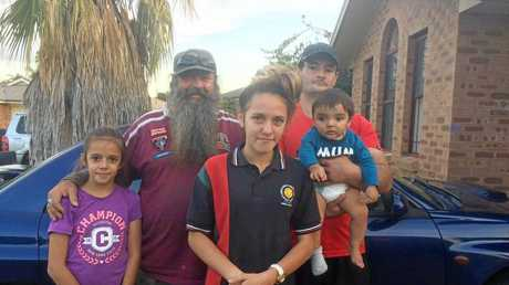Mick Peet with Lateesha Nolan's brother Chris and his partner and family.