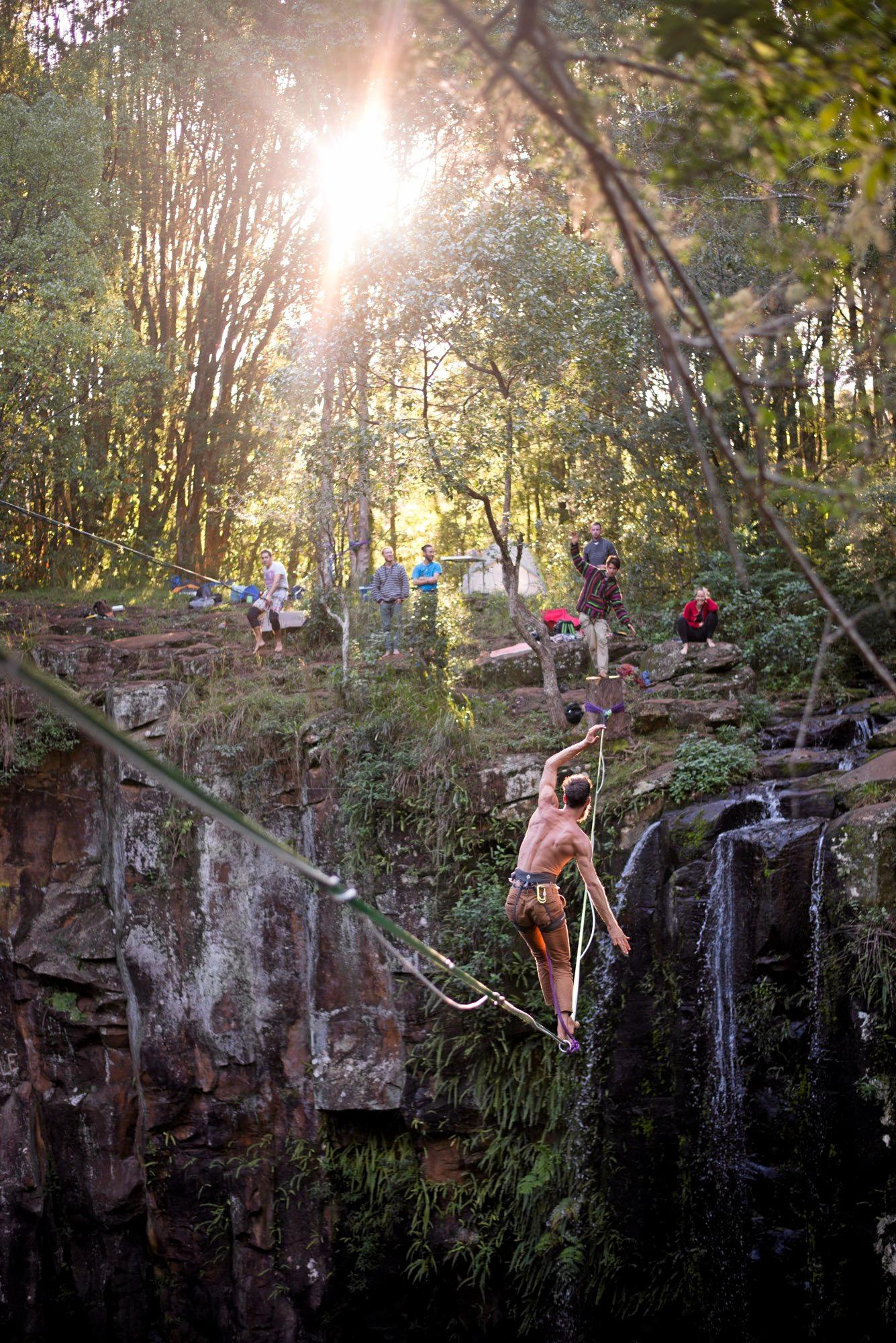 HIGH LIFE: Dan Willersdorf traverses a highline over a waterfall at Dalwood in NSW.