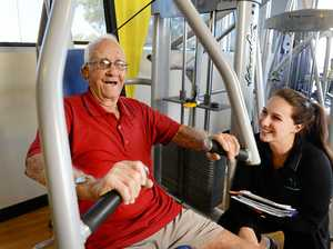 GOOD TIMES: 93-year-old Second World War veteran Ken Smith is glowing with health as he takes part in a program run by Active Body Conditioning at Goodlife Health Club. Ken is pictured with exercise physiologist Emily Beck.