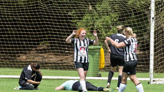 Esther Ritchie (left) celebrates her goal for Willowburn with Leah Gatfield.