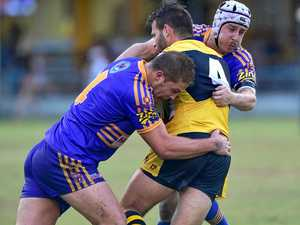 IN ACTION: Noosa players tackle a Caloundra player during a game last year.