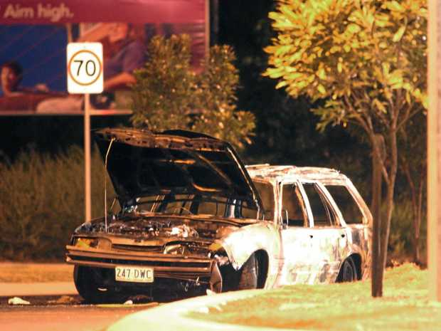 An image of the burnt out car on Springfield Parkway taken on June 10, 2004.
