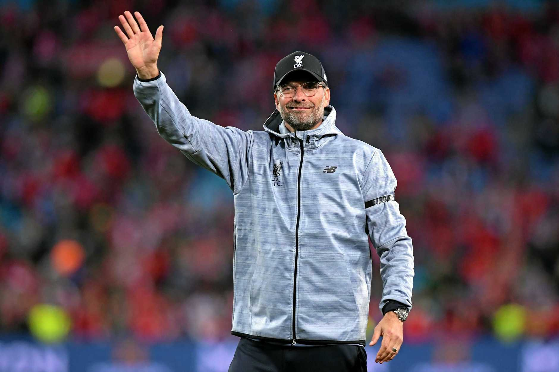 Liverpool coach Jurgen Klopp waves to the crowd following the exhibition match between Sydney FC and Liverpool FC at ANZ Stadium in Sydney on Wednesday, May 24, 2017. (AAP Image/Paul Miller) NO ARCHIVING, EDITORIAL USE ONLY