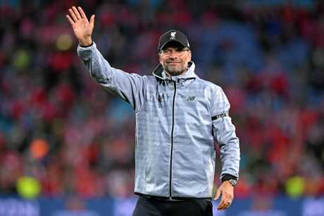 Liverpool coach Jurgen Klopp waves to the crowd.