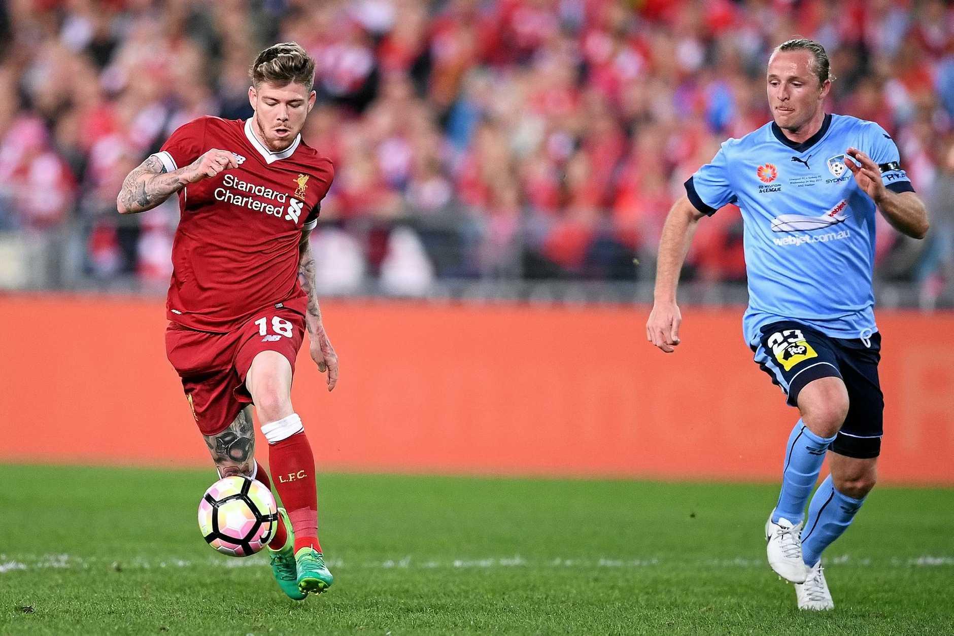 Alberto Moreno of Liverpool controls the ball.