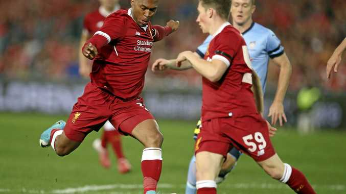 Liverpool FC's Daniel Sturridge takes a shot on goal to score against Sydney FC.