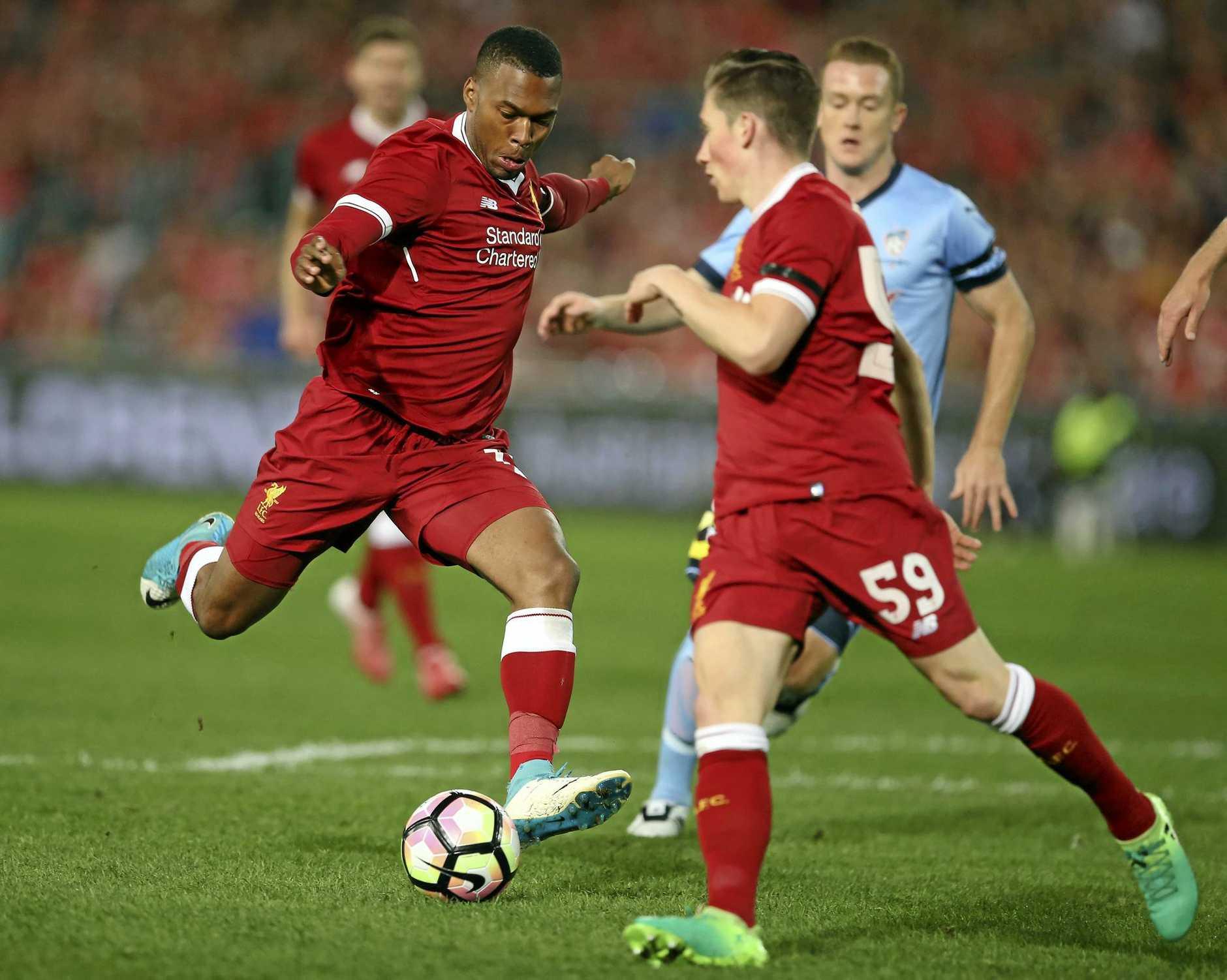 Liverpool FC's Daniel Sturridge takes a shot on goal to score against Sydney FC.