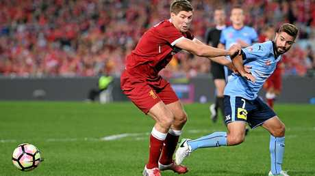 Steven Gerrard of Liverpool competes for possession with Michael Zullo of Sydney FC.