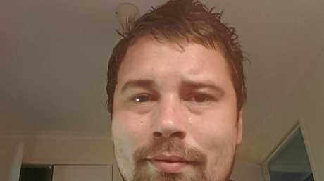 BITE VICTIM: Layne Smith, 28, was attacked by a black dog on May 14, and is still suffering from the injuries weeks later.