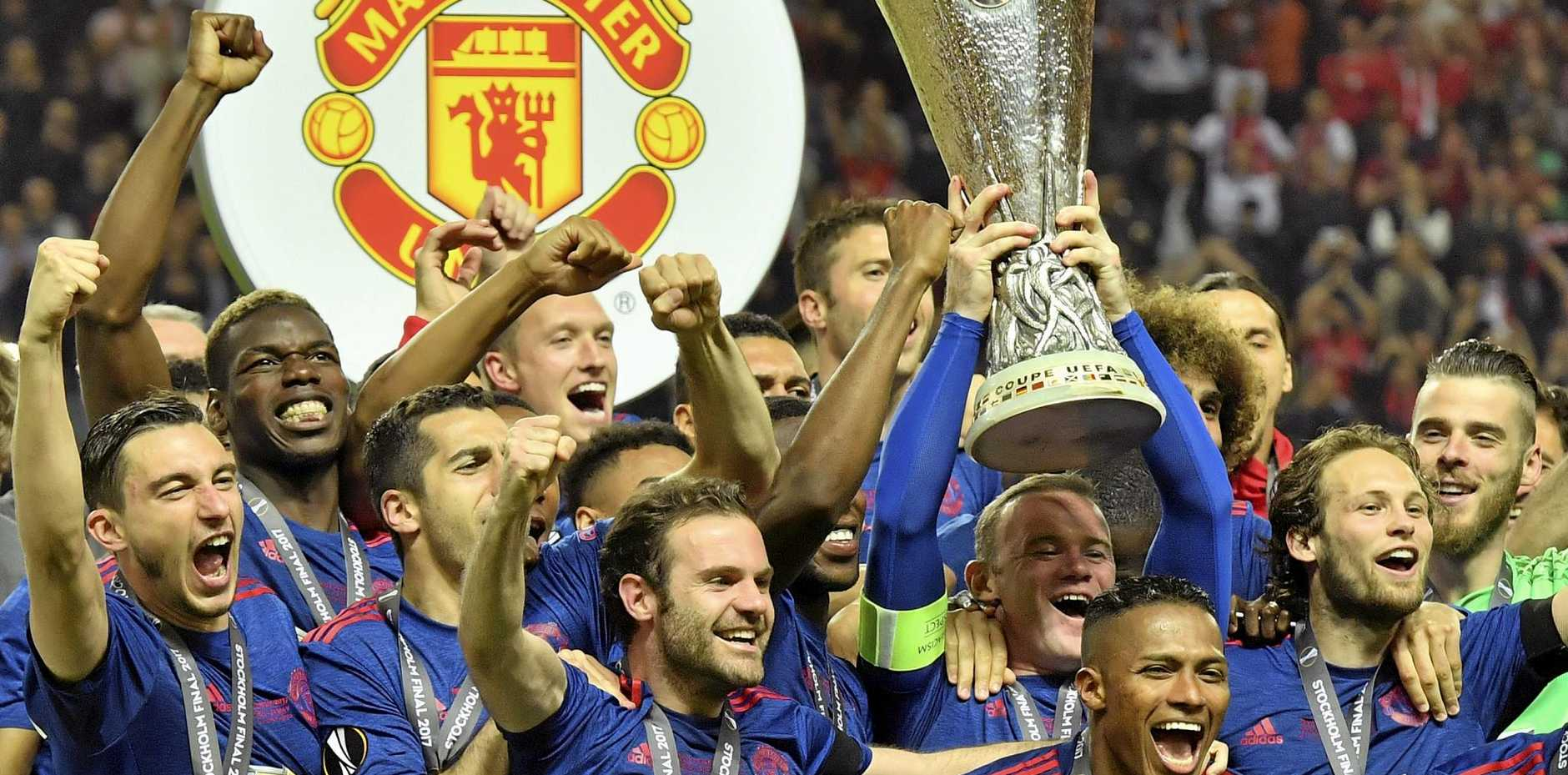 Manchester United's Wayne Rooney lifts the trophy after his side won the Europa League final.