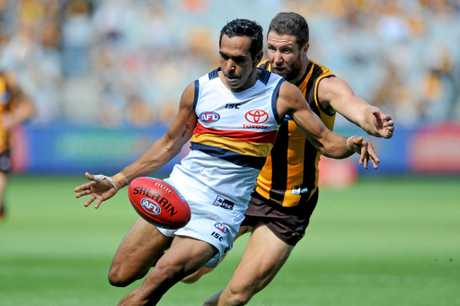 Eddie Betts of the Crows outruns James Frawley of the Hawks.