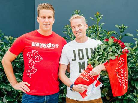 Peter Oxford (right) with his partner Andre Sarzio who both support the National Cystic Fibrosis 65 Roses Campaign.