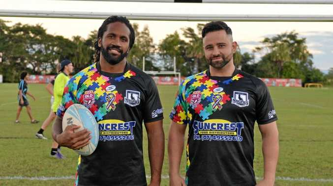 Jardine Bobongie (left), who returns to the Magpies after a knee reconstruction, and Lee Williams show off the team's Autism Awareness jerseys, which will be auctioned to raise funds for Autism Australia.