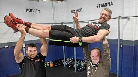 DOIN' IT FOR DES: CrossFit Confront members (from left) Paul Dolley who also owns Dolley Concrete, coach Warrick Bidwell and owner Jason Erbacher host an in-house competition fundraiser for a tradie who lost his tools.