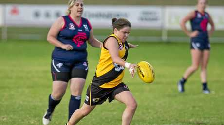 KICKING IN: Mariah Pasfield in action for Toowoomba Tigers.
