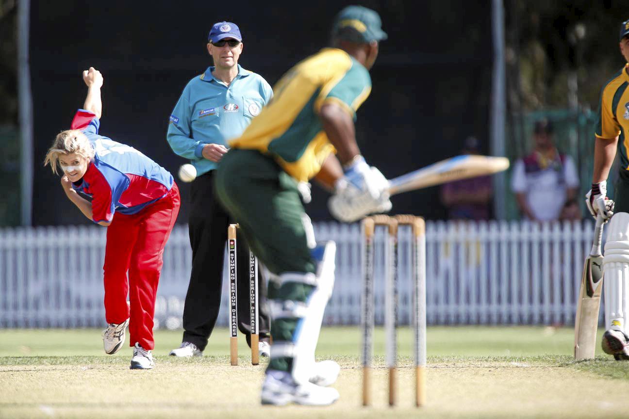 Former Grafton and now NSW cricketer Kara Sutherland bowling to cricket legend Sir Viv Richards. Photo: MARK NEWSHAM