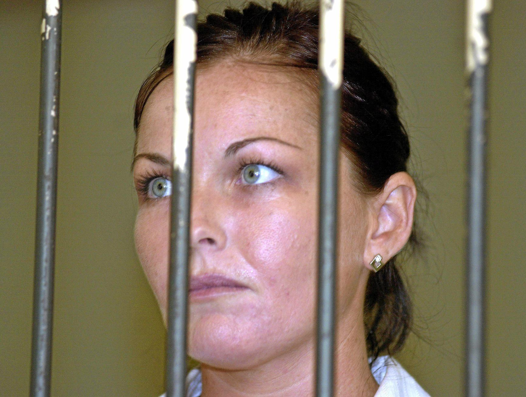 Convicted drug smuggler Schapelle Corby stands behind the bars at court's prison before her appeal trial in Denpasar's court, Bali, Indonesia, in 2005.