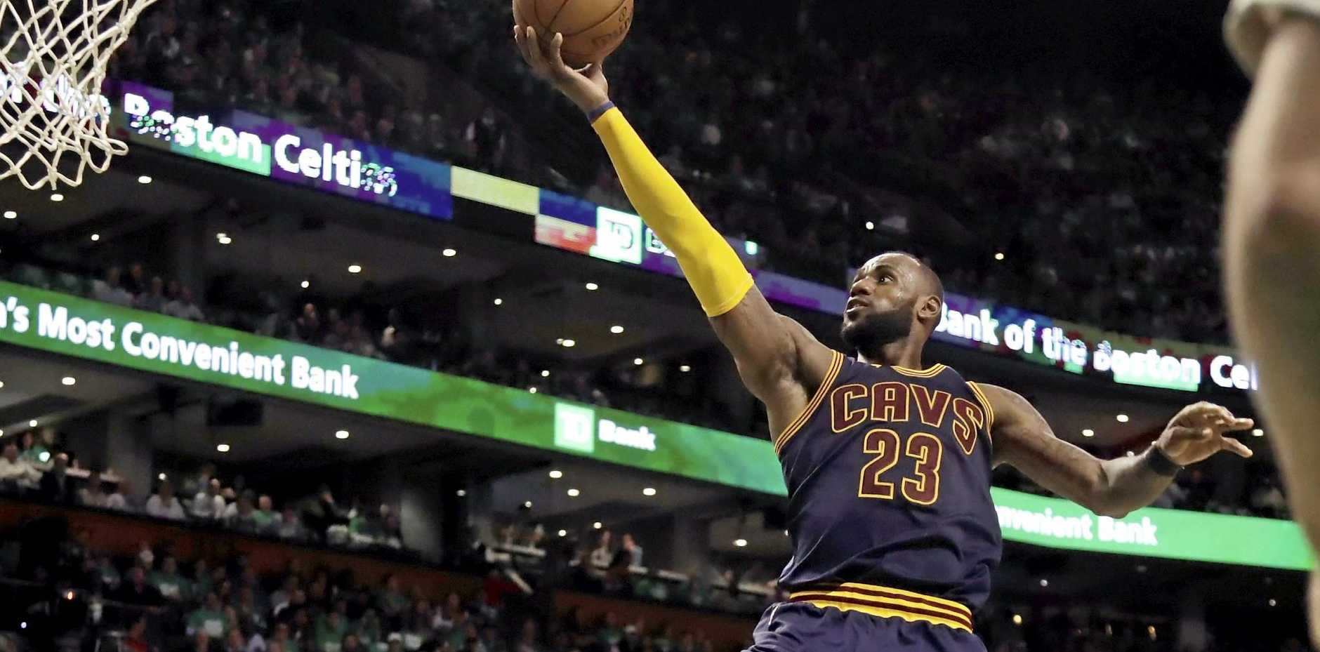OUTDOING JORDAN: Cleveland Cavaliers forward LeBron James (23) soars to the basket
