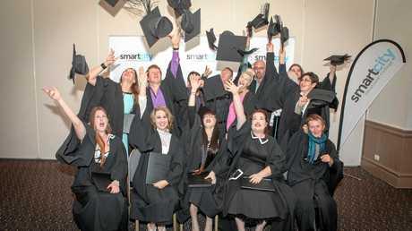 BETTER DAYS: A SmartCity Graduating class celebrate.