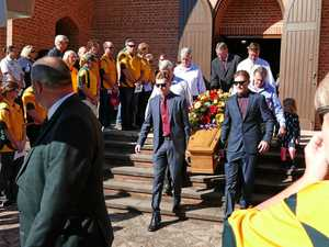 The coffin containing Grafton identity Neville Lollback is carried down the steps of Christ Church Cathedral after a moving farewell witnessed by hundreds of mourners.
