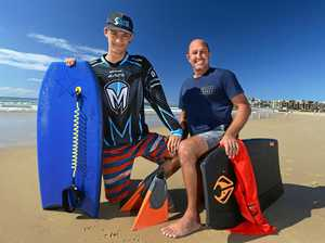 Keegan Herbert-Cummings (left) was on his bodyboard at Alexandra Headland with his support worker Michael Eppelstun when they noticed a man struggling in a rip.
