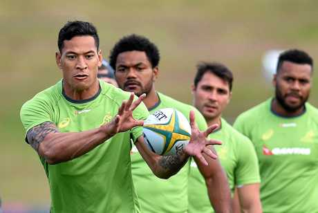 Israel Folau runs onto the ball during a Wallabies training session.