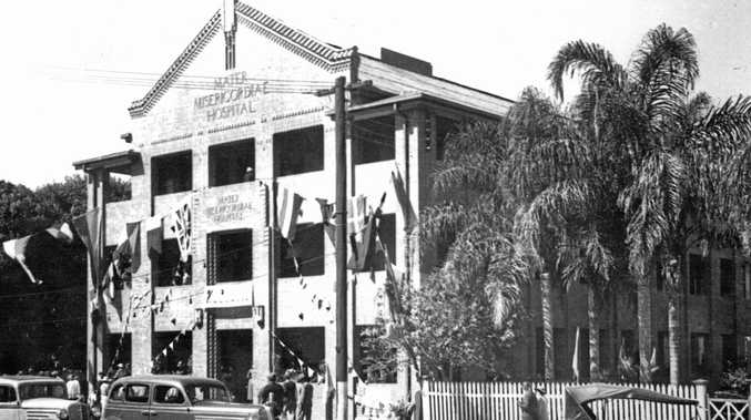 NEW HOSPITAL: Flags and bunting adorn the Gordon Street entrance of the Mater Hospital during its official opening in August 1936. Sydney Street Markets now stands on the site.