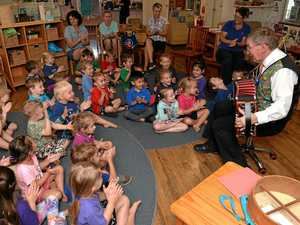 Performer Mike Jackson entertains the children at the Pioneer Community Kindergarten.