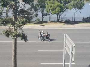 Man battles traffic on mobility scooter in Brisbane