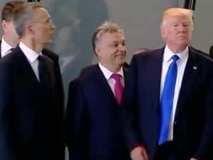 Donald Trump shoves NATO leader aside