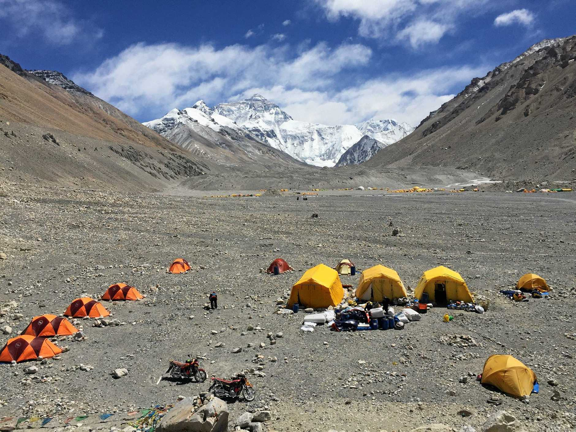 A photo of base camp with Mt Everest in the background