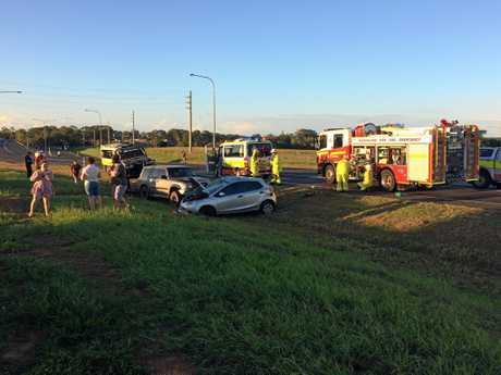 Emergency service crews at the scene of a two-vehicle crash.