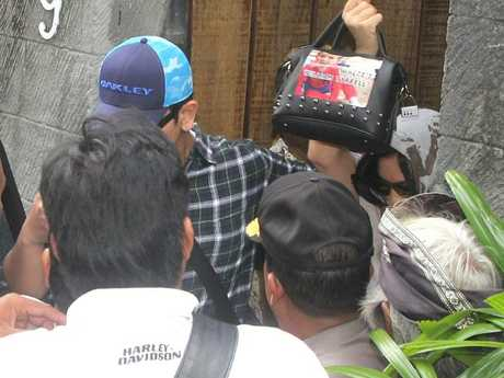 Police securing Schapelle Corby (holding handbag) leaving the house in Kuta lane to go to Parole Board with a picture of William Tyrell on the bag. Picture: Lukman S. BintoroSource:News Corp Australia