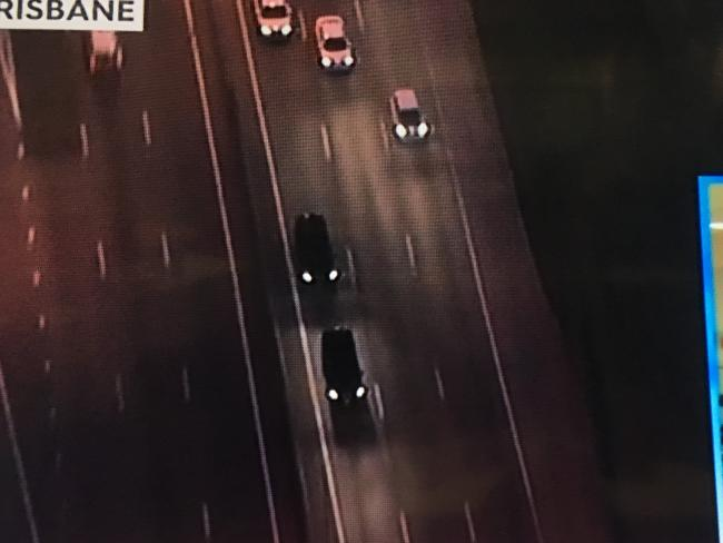 A convoy of cars, one of which contains Schapelle Corby, heads south from Brisbane Airport.