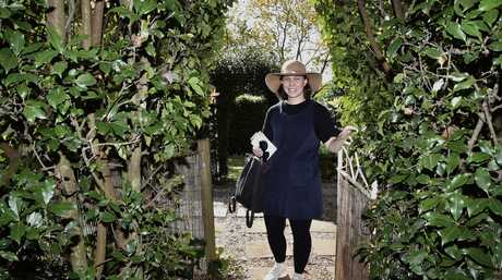 Sally McHugh explores the garden at Augusta's Cottage in Campbell St.