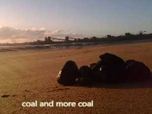 Lance Payne picking up coal from local beach