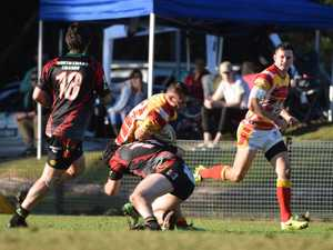 Daneil Donovan of the Coffs Harbour Comets is stopped