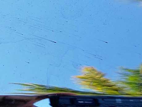 DODGY JOB: Tar smeared across the car windscreen