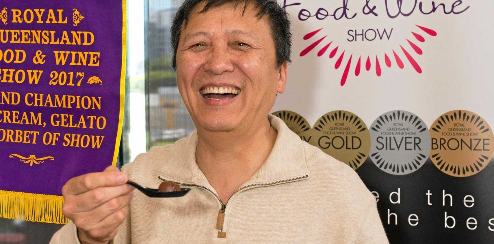 Yue Lin, from Milani House of Gelato, tasting his Grand Champion dark chocolate sorbet.