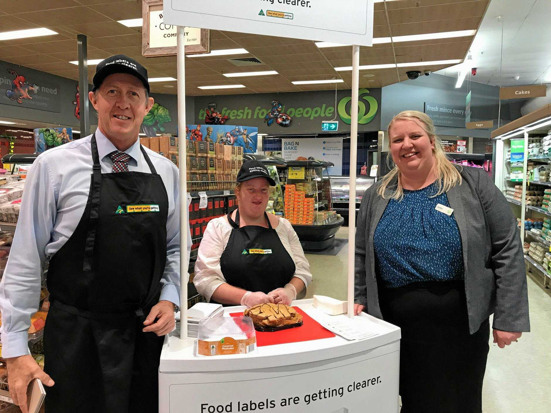 Deputy Prime Minister, Luke Hartsuyker with staff at Woolies in Byrn Bay.