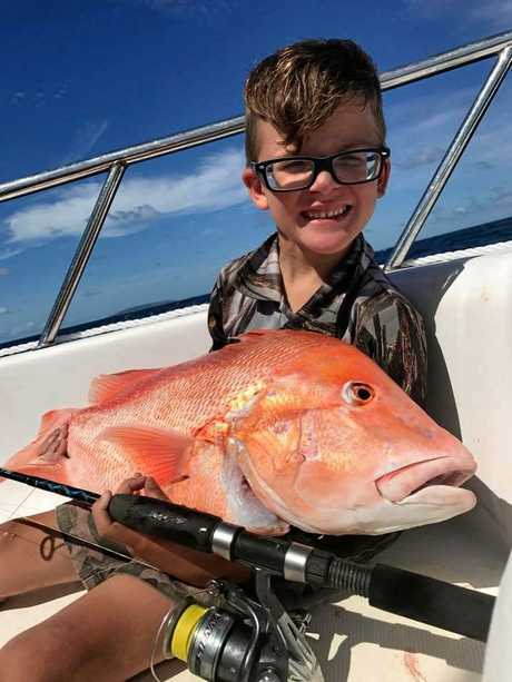 Brayden Lewis with his great catch, a 5.8kg red emperor caught off Derwent Island on 30-pound line.