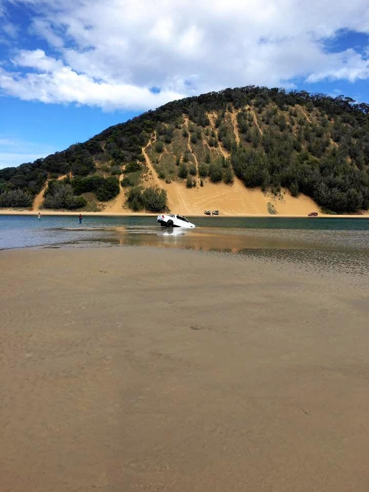 4WD comes unstuck on sand bar at Double Island Point.